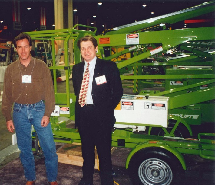 Niftylift's first US Customer (left) stands with John Keely